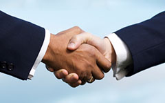 Handshake after buying a home | Youngs Legal Blog